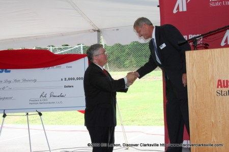 APSU President Tim Hall shakes hands with Hemlock Semiconductor LLC President and CEO Rick Doornbos after the University was presented with a 2 million dollar donation.